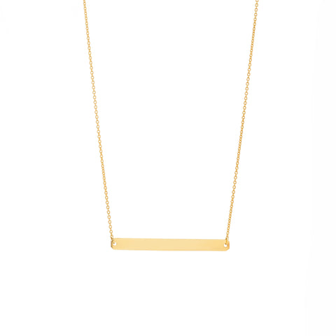 A narrow straight horizontal gold pendant with inscription on a gold chain