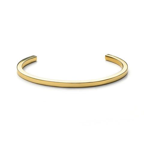A thin, sleek gold cuff with squared ends and inscription