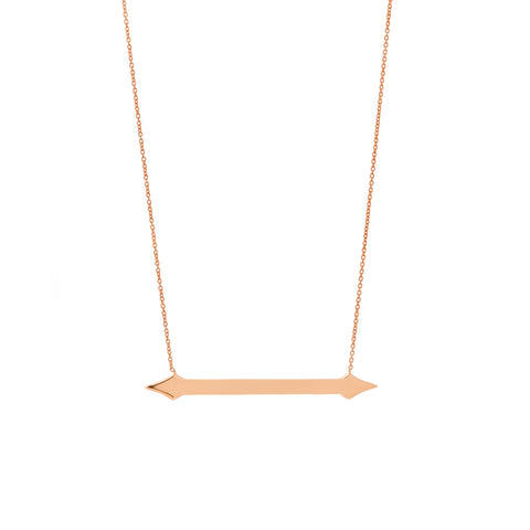 A horizonal gold pendant with arrow ends on gold chain and inscription