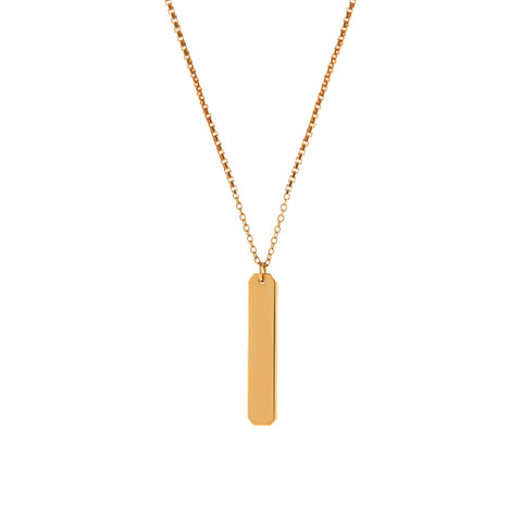 A short vertical gold pendant with inscription on a gold chain