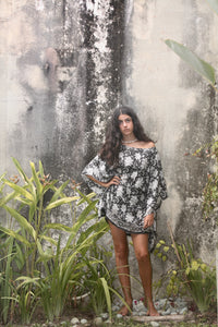 block printed silk kaftan dress, white floral print on black ground. Resort wear.