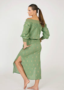 khaki cotton midi-length dress, off the shoulder, block printed with gold leaf motif, resort wear, beach wear