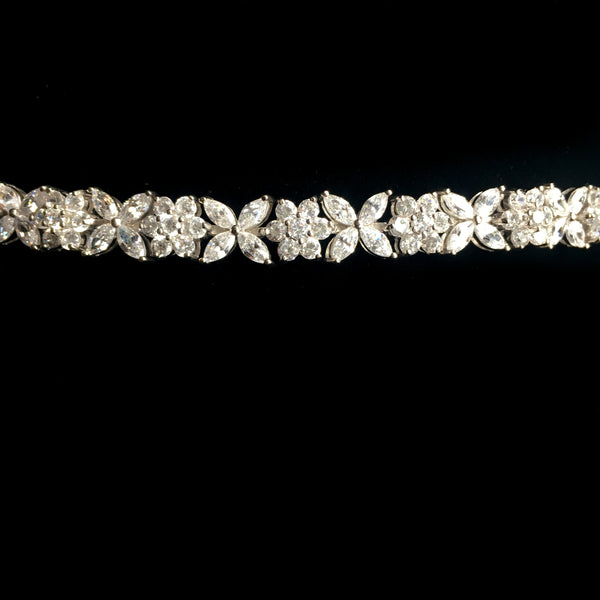 Sparkling Silvertone Bracelet Adorned with Flower Shaped CZs