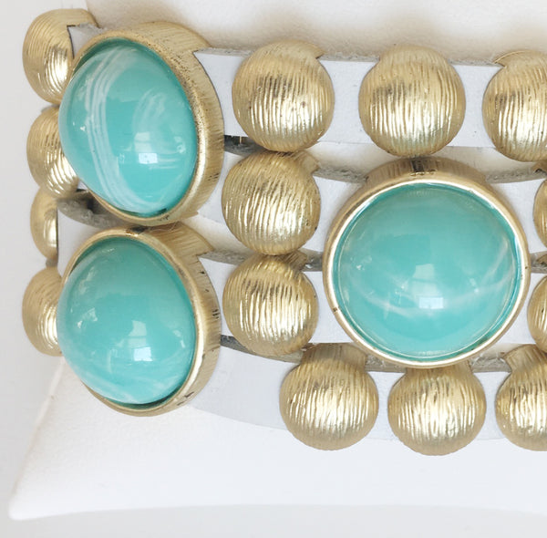 Bursting Goldtone Beads and Turquoise Resin Accents Adorn this White Leather Bracelet with Magnetic Clasp