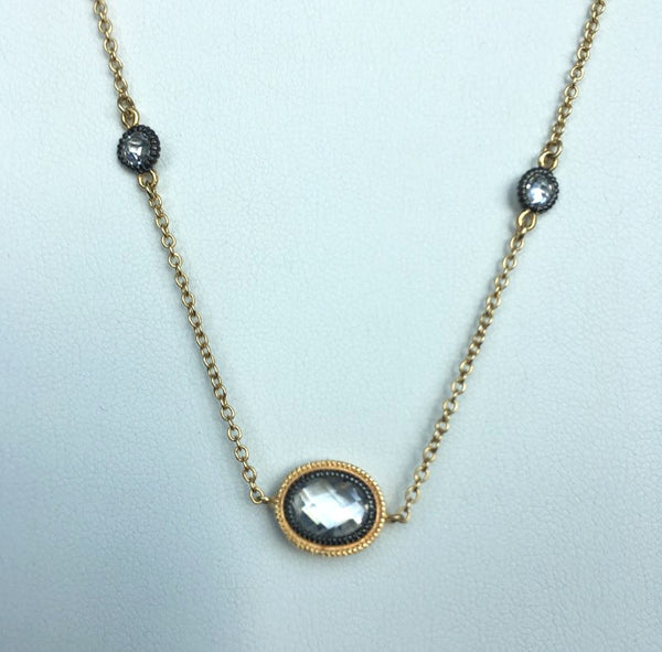 14k gold plated over silver with black rhodium and clear CZs, 36""