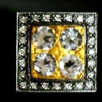 Square white topaz cufflinks set in gold and surrounded by diamonds and silver