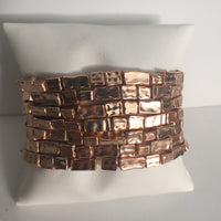 Cluster of Rose Gold Plated Stretch Bracelets