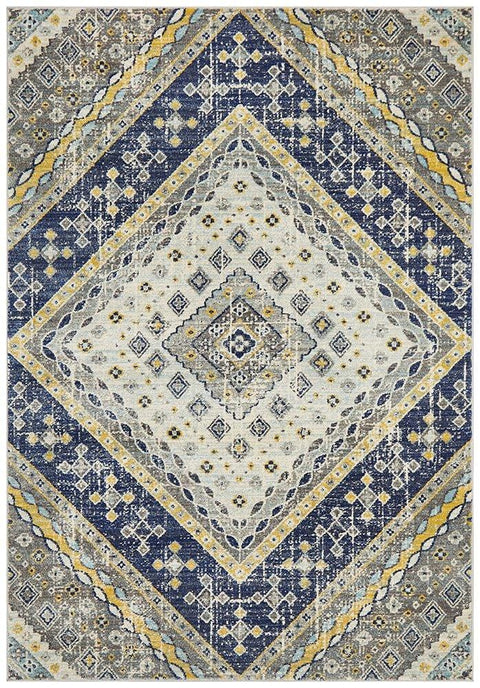 leshara-blue-and-yellow-medallion-distressed-rug-missamara.jpg