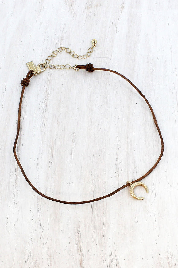 WORN GOLDTONE DOUBLE HORN CHARM BROWN CORD CHOKER