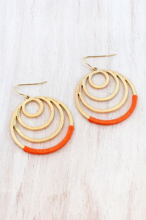 ORANGE FABRIC-WRAPPED WORN GOLDTONE GRADUATED CIRCLE EARRINGS