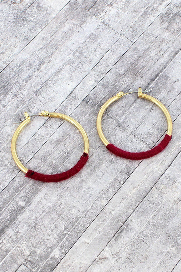 MAGENTA FABRIC-WRAPPED WORN GOLDTONE HOOP EARRINGS