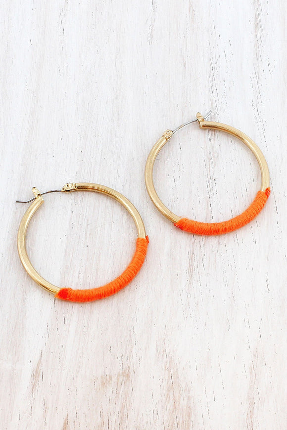 ORANGE FABRIC-WRAPPED WORN GOLDTONE HOOP EARRINGS