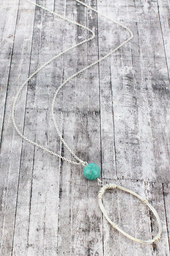 WORN SILVERTONE WIRE-WRAPPED OVAL AND TURQUOISE BEAD PENDANT NECKLACE