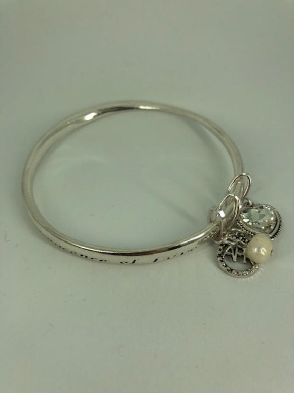 APRIL BIRTHSTONE 'INNOCENCE & LOVE' SILVERTONE TWIST BANGLE WITH CHARMS