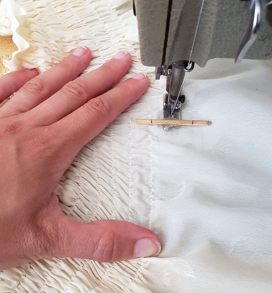 showing the boder guide foot in use while sewing shirring