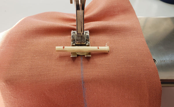 The fist row of shirring is sewn following the chalk guideling