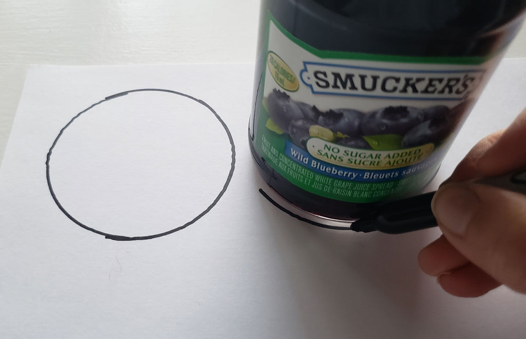 Tracing around the bas of a jar to create two circular shapes