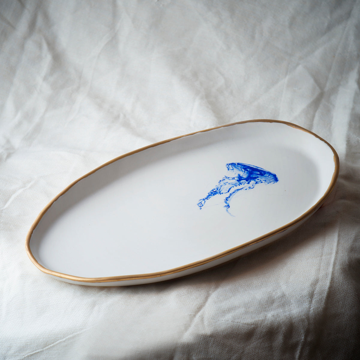 Serving plate with jellyfish and gold