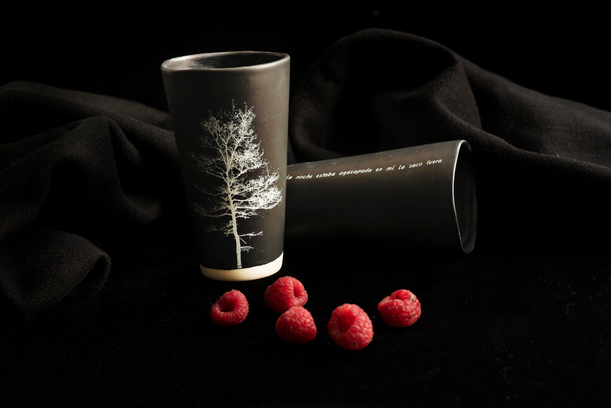 black handmade Adarbakar tumblers with a photograph on one side and a poem on the other