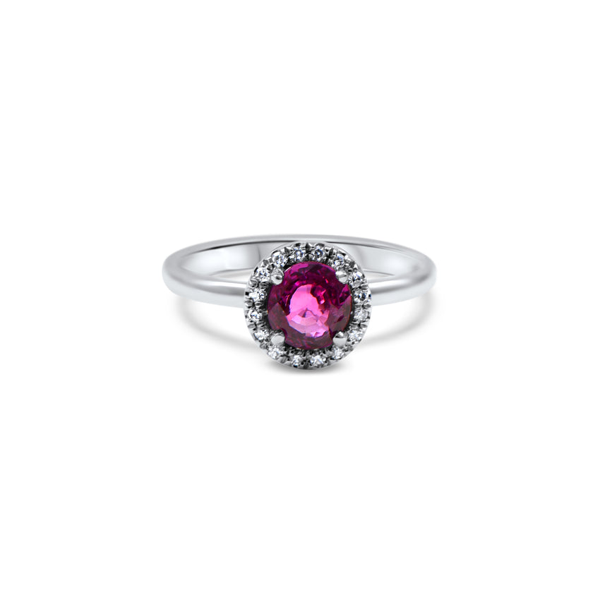 Bague de Fiançailles sertie d'un saphir rose de culture de 0.75ct avec un halo de diamants de culture