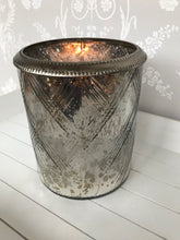 Short glass vase / candle holder