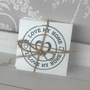 "White wooden ""I love my home"" coaster set"