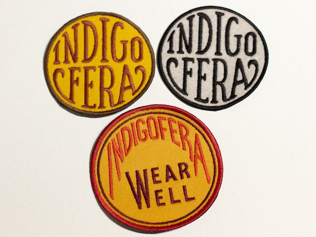 Indigofera Yellow/Brown round badge