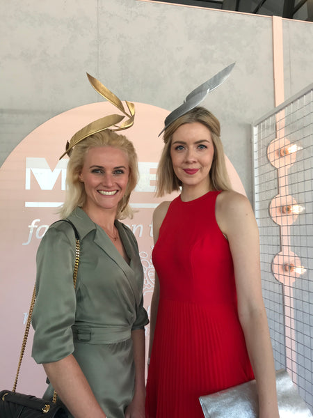 Georgina Egan (model) and Louise from Georgette Millinery (right). At Oaks Day, Melbourne. #Gold #Headpiece #Feather #crown