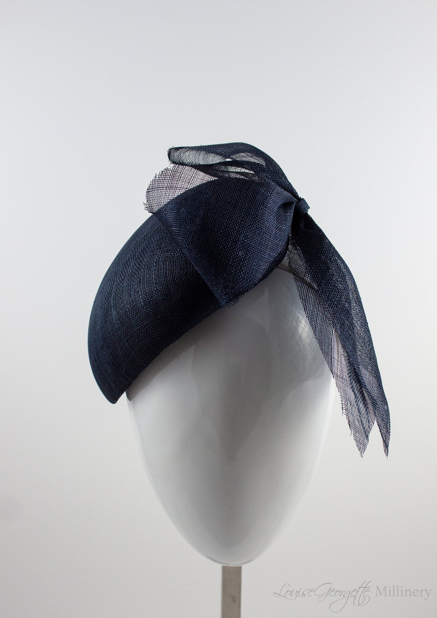Font view. Luxurious Pinokpok hat with navy straw bow placed on a timeless Beret shape. Hat suitable for Royal Ascot, Epsom races, Weddings, and other special occasion outfits. Handmade Millinery made in London.