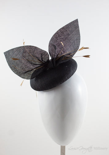 Black straw hat suitable for weddings, special occasions and race days. A popular straw style, our signature fun and timeless hat suits most face shapes and can be made in bespoke colours upon request.