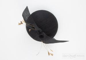 Black straw hat with gold feathers. Suitable for weddings, special occasions and race days. A popular straw style, our signature fun and timeless hat suits most face shapes and can be made in bespoke colours upon request.