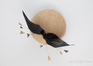 Top view. Cream straw hat with gold feathers and black bow. Suitable for weddings, special occasions and race days. A popular straw style, our signature fun and timeless hat suits most face shapes and can be made in bespoke colours upon request.