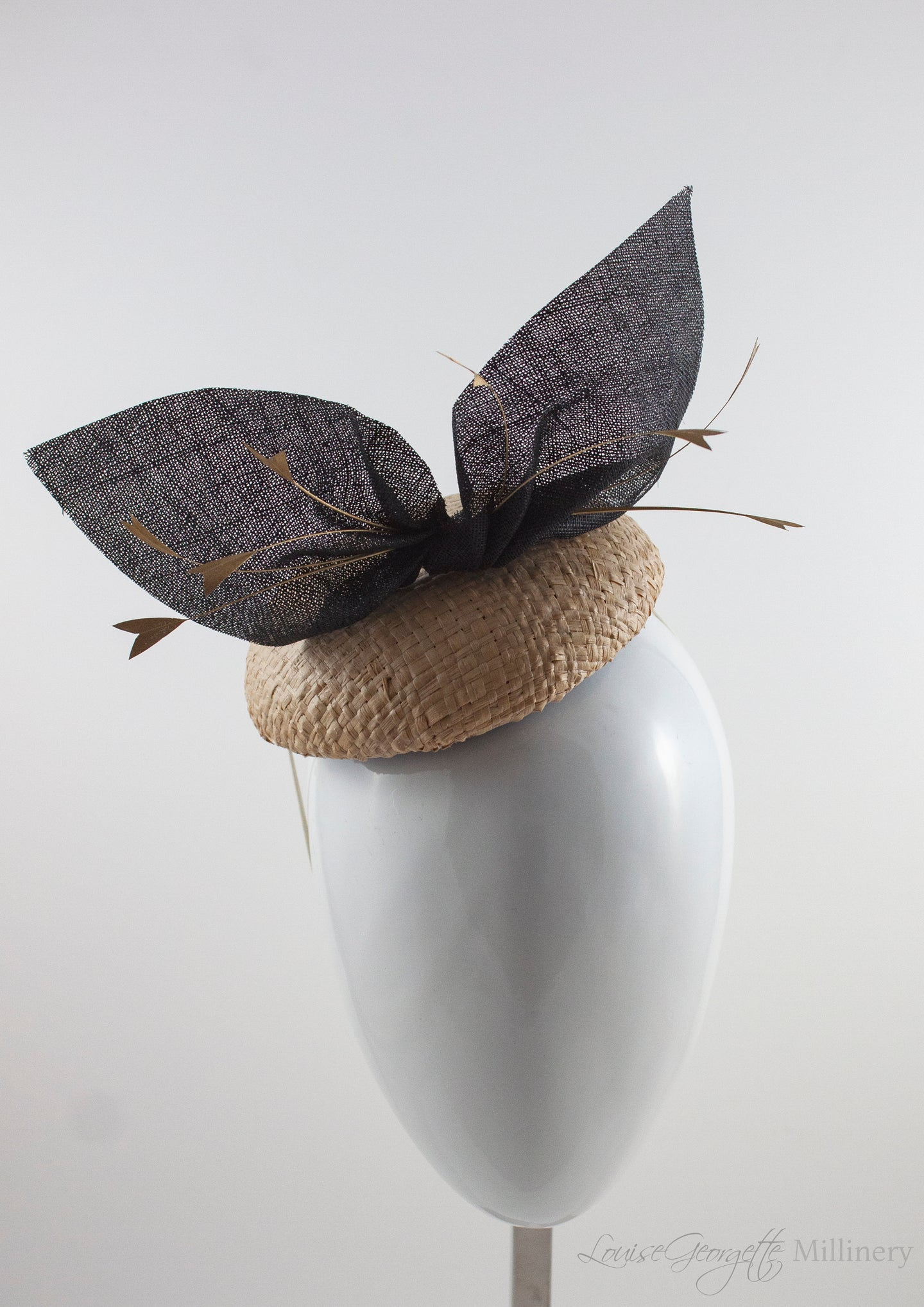 Cream straw hat with gold feathers and black bow. Suitable for weddings, special occasions and race days. A popular straw style, our signature fun and timeless hat suits most face shapes and can be made in bespoke colours upon request.