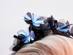 Black and Metallic silver flower crown on headband. Close up. Handmade millinery made in London.