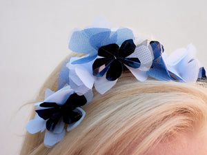 Pale blue, Navy and white flower crown on headband. Close up. Handmade millinery made in London.