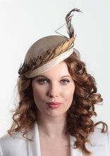 Allegra gold feathered straw Beret on model. Millinery handmade in London. Front view.