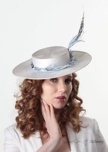Model wearing Amherst feather Pale blue and white Boater Hat. Handmade Millinery made in London.  Front view.