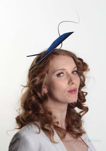 Navy two quill headband or fascinator on Model. Side view. Handmade millinery made in London.