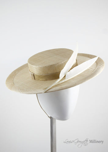 Natural coloured straw boater hat with two cream feathers. Handmade London Millinery. Side view.