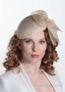 Cassandra natural straw Beret with side bow. Model front view. Handmade Millinery made in London.