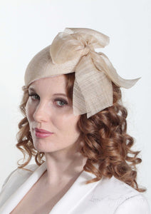 Cassandra natural straw Beret with side bow. Model side view. Handmade Millinery made in London.
