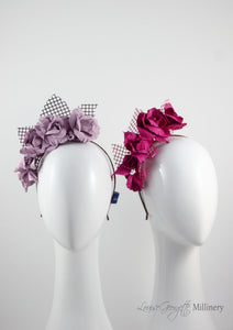 Leather roses on headband with reflective lattice detail. Millinery handmade in London. Front view. Pink and Lilac