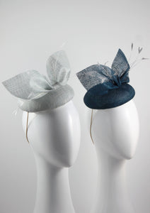 Royal and Ice Blue pinokpok pillboxs with bow and feather detail. Handmade Millinery made in London - Louise Georgette Millinery Front view.