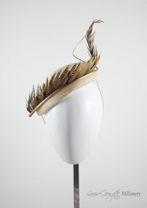Allegra gold feathered straw Beret. Millinery handmade in London. Front view.