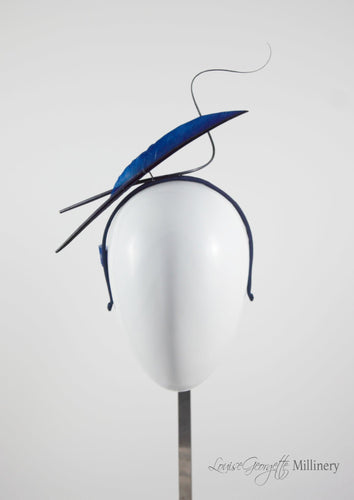 Navy two quill headband or fascinator. Front view. Handmade millinery made in London.