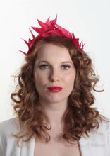 Hand sewn red feathers in tiara crown shape. Handmade in London and made to order. Model Front view.