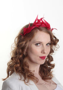 Flame feather tiara crown. Millinery handmade in London. Model side view.