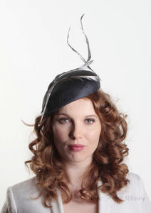 Navy two feather Beret. Millinery handmade in London. Model front view.