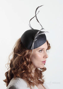 Navy two feather Beret. Millinery handmade in London. Model side view.
