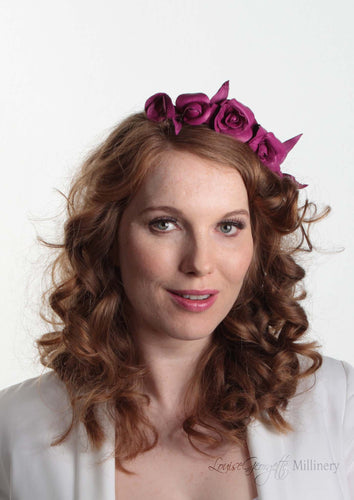 Mini Rosie Cerise Flower Crown for weddings and special occasions. Front view on model.